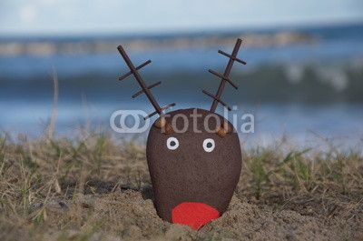 Reindeer head painted on a stone