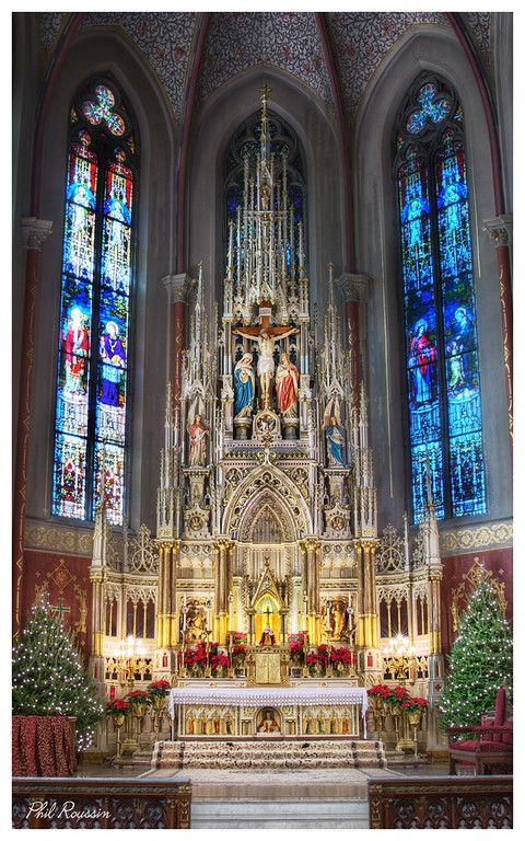 The High Altar at Saint Francis de Sales stands 52 feet tall and features a painted sculpture of the Crucifixion in its upper register. Saint Francis de Sales Oratory, Saint Louis, MO.