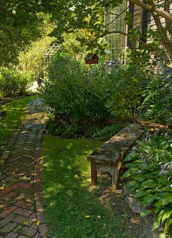 Peaceful Shady Garden...old brick walkway...hostas...old weathered bench...birdhouse.