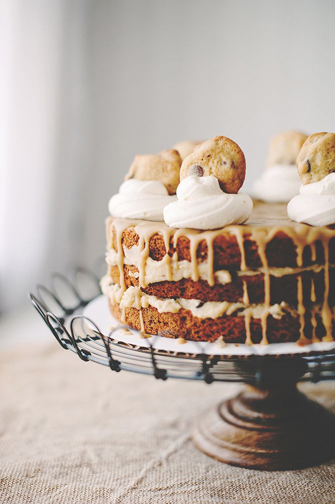chocolate chip cookie layer cake with cookie dough filling, salted caramel icing, and brown sugar buttercream dollops