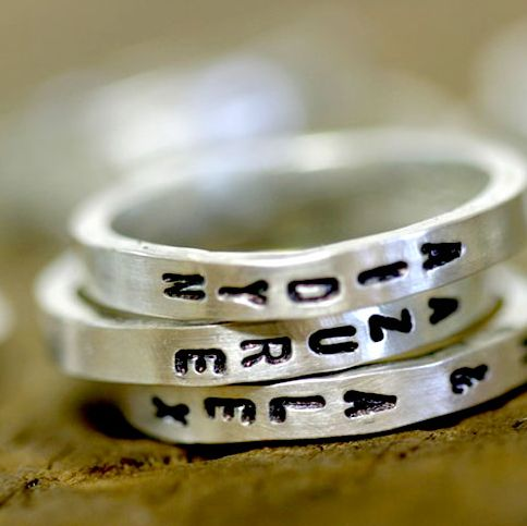 Kid's names, favorite quote, or funny joke would be wonderful stamped on this set of 3 custom stacking rings.    There is a slight oxidation on each ring to give it a rustic and natural appearance.    Each ring is about 2.5mm wide.    Single rings can be purchase in my store too.