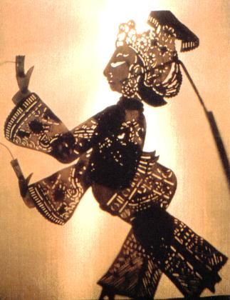 Shadow puppet-- cut out holes and jonted figures are wonderful, and consider translucent fabrics as possible materials as well.