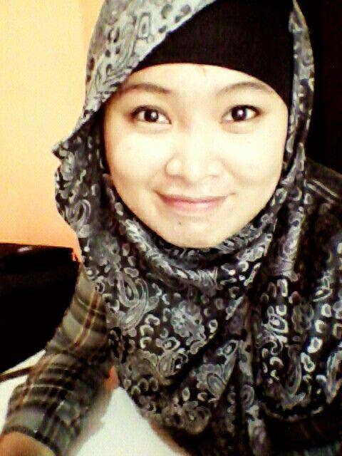Me.. On hijab style grey.. Flower