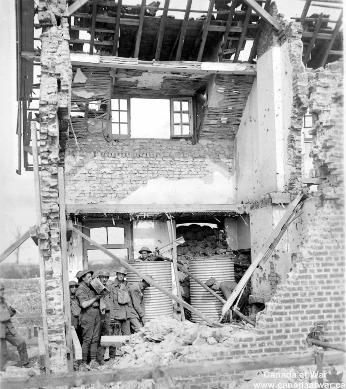 Water Tanks near Lens - Canadian soldiers used this ruined house west of Lens to shelter their water tanks. From here, water would be carried forward to soldiers in the trenches. This photo was taken in September 1917, about a month after the battle. CWM 19920085-786
