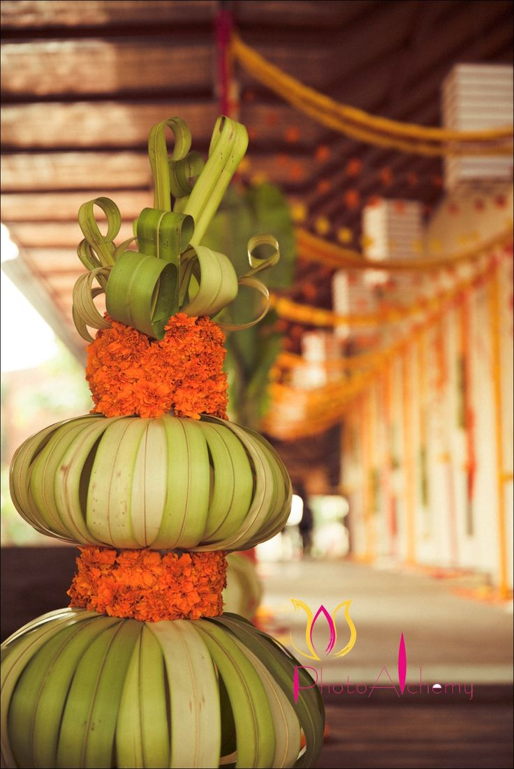 Coconut leaf vase - ecofriendly, pretty, fun! www.3productionweddings.com www.facebook.com/3Productions #weddingdecor