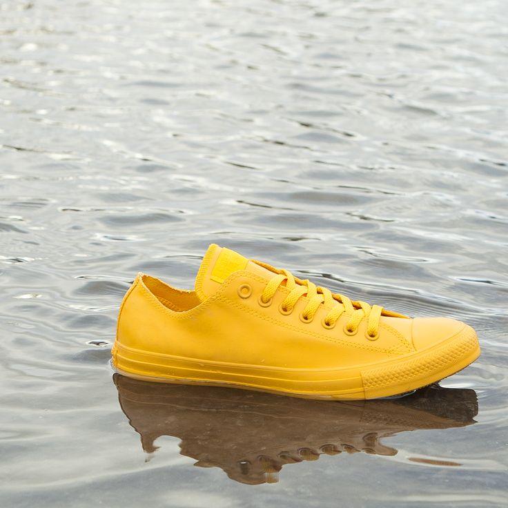 Beat the rain in some rubber Chucks.