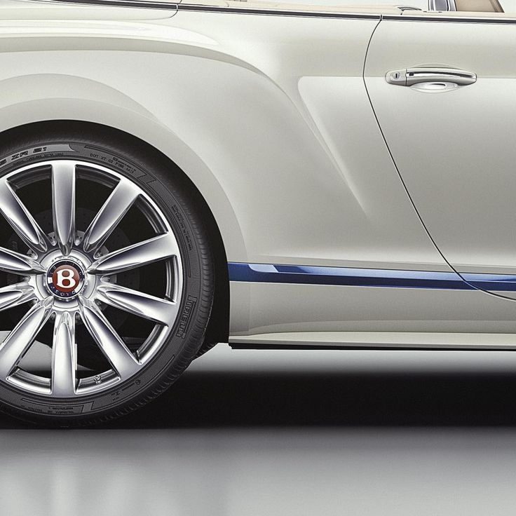 "A flash of Sequin Blue on the lower brightware, gives this #Mulliner Limited Edition the impression of a yacht floating on tranquil waters. Spec: Glacier White paint with 21"" Ten Spoke Propeller Wheels. Link in bio."