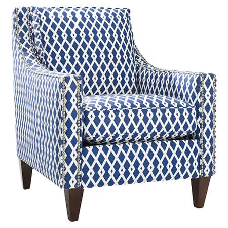 Bring eye-catching style to your living room or master suite with this bold nailhead-trimmed arm chair, showcasing trellis-print upholstery and a wood frame....