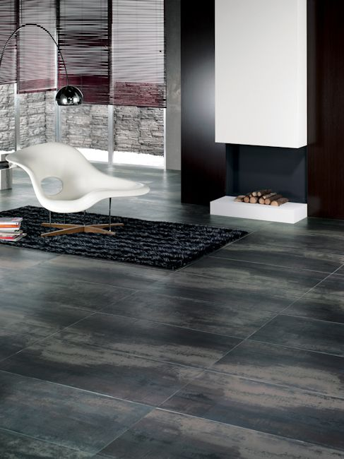 Ironworks porcelain tile by Artistic Tile looks masculine and chic in this living space!