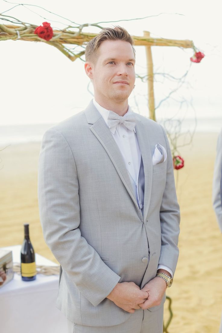 Groom looks good in his grey tux and lavender bow tie