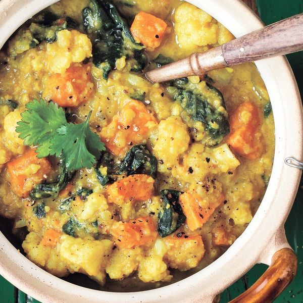 From Angela Liddon's Oh She Glows book, this is a healthy, vegan Indian Lentil-Cauliflower Soup recipe. Lentils and cauliflower are budget-friendly, and perfect with the warming Indian spices.