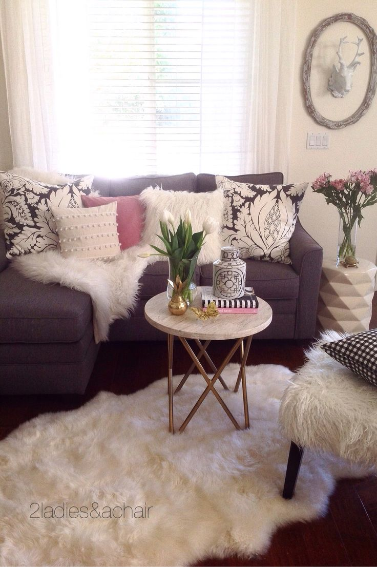 HomeGoods has the perfect accent pieces to compliment your home decor. This stone top table is exactly right for this size sofa. Sponsored by HomeGoods
