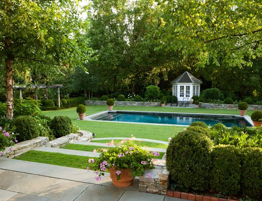 Beautifully landscaped back yard and swimming pool.