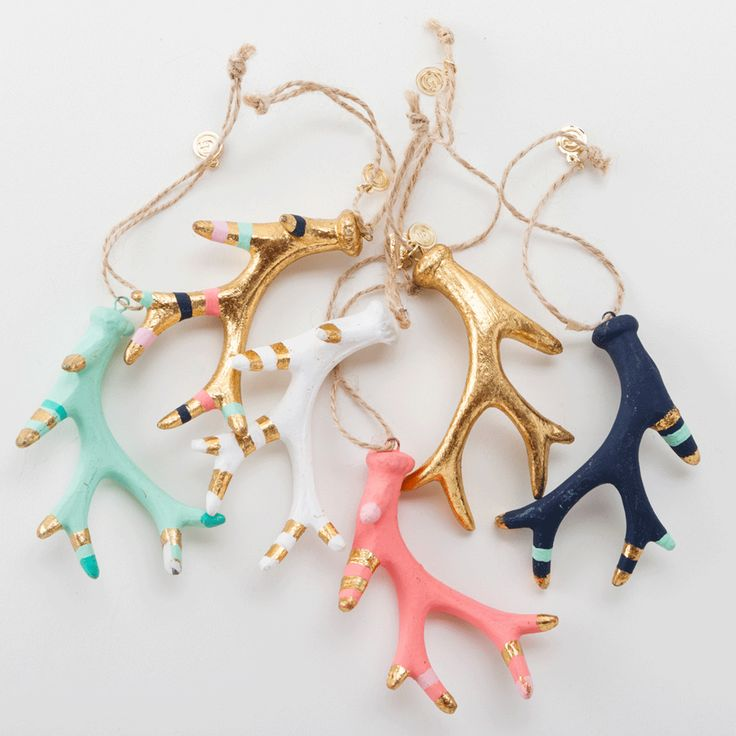 Your mantel needs these adorable pastel antler ornaments.