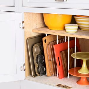 Inexpensive Tricks to Organize Your Kitchen: Make Cookie Sheets and Cutting Boards More Accessible With Tension Rods
