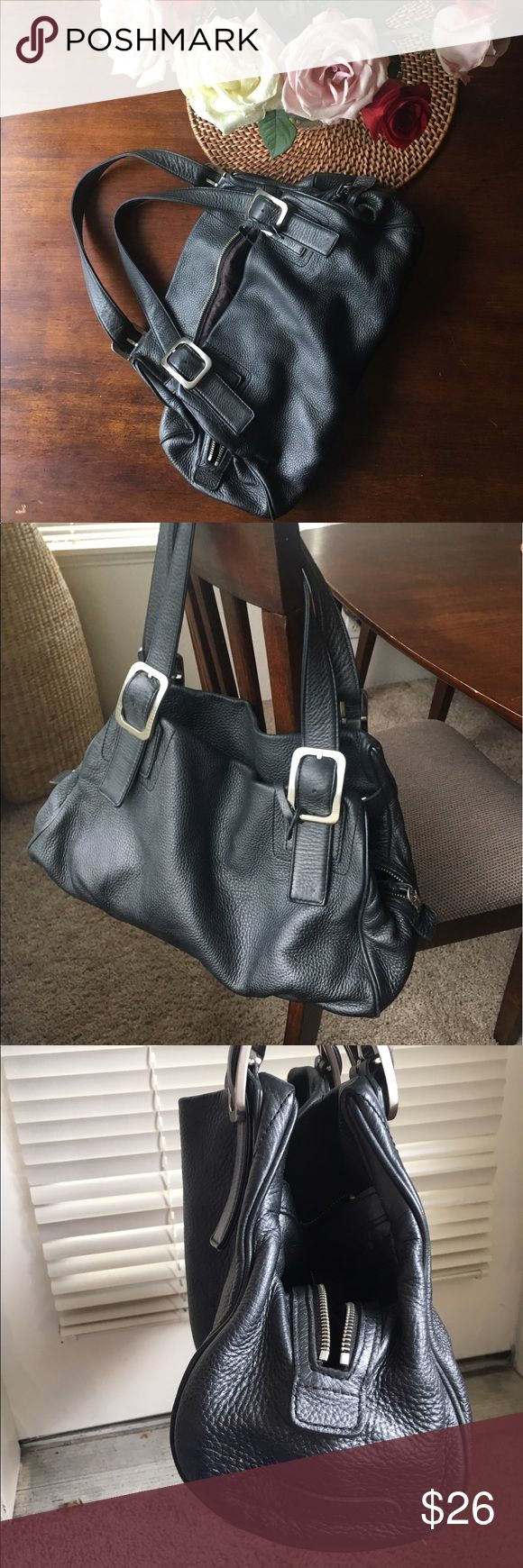 Cole Haan Purse Cole Haan leather shoulder bag.  Pewter color, soft leather.  Lots of pockets and storage.  Some signs of wear- spot in the bottom of the bag.  A lot of life left in this beautiful bag! Cole Haan Bags Shoulder Bags