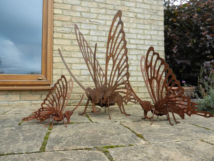 Three rusty metal butterfly garden sculptures available in 30cm, 53cm and 83cm heights