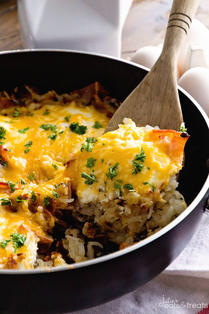 Cheesy Bacon Egg Hash Brown Skillet ~ Delicious, Easy Breakfast Skillet Loaded with Crispy Bacon, Hash Browns, Cheese and Eggs! You Can Even Serve it For Dinner! ~ http://www.julieseatsandtreats.com