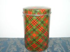 ANTIQUE BISCUIT TIN WITH TARTAN DECOR.