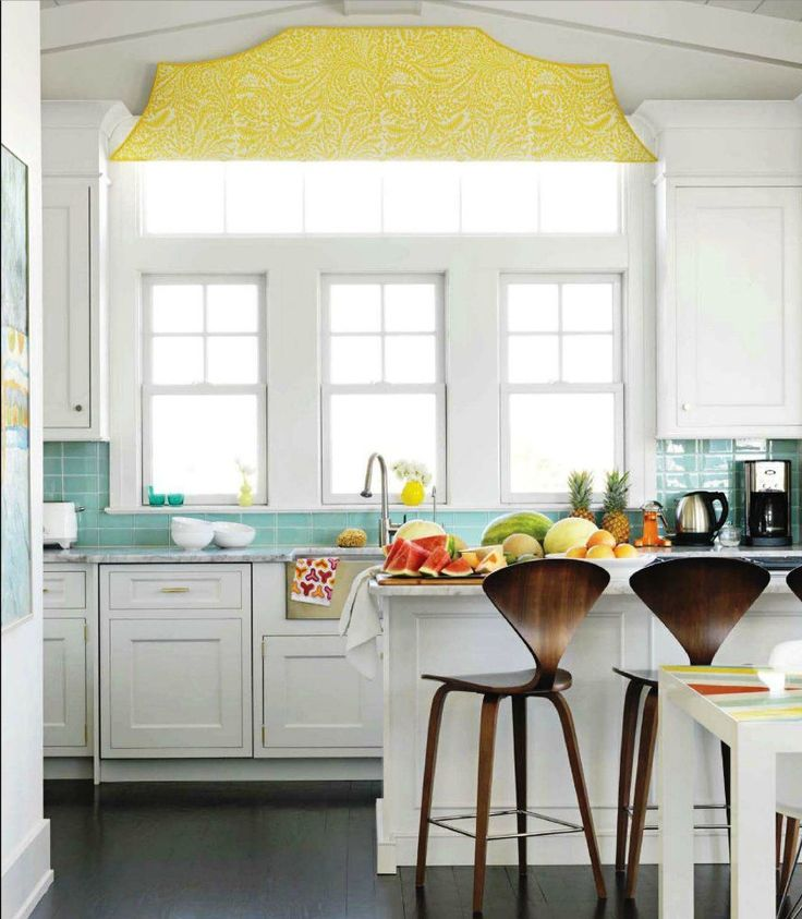 bright white kitchen with turquoise and yellow accents interior