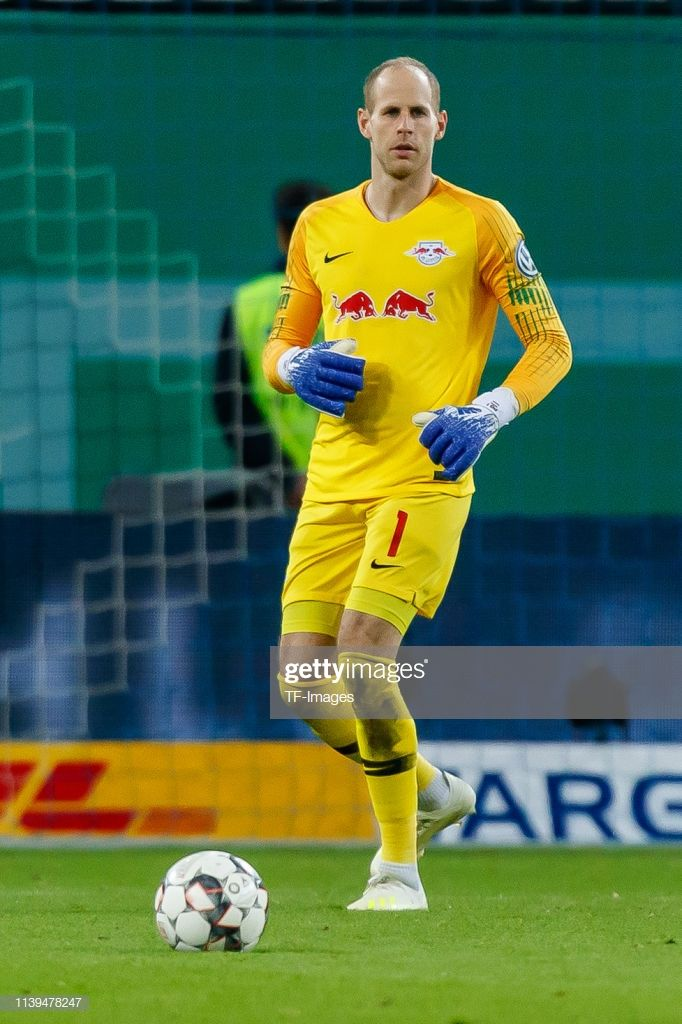 Goalkeeper Peter Gulacsi of RB Leipzig controls the ball during ...