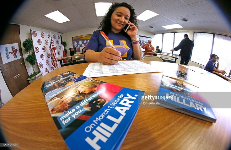 Volunteer Maria Nuno-Estrada, speaks with a voter on Super Tuesday at Democratic presidential candidate Hillary Clinton's Dallas headquarters March 1, 2016 in Dallas, Texas. 13 states and American Samoa are holding presidential primary elections, with over 1400 delegates at stake.