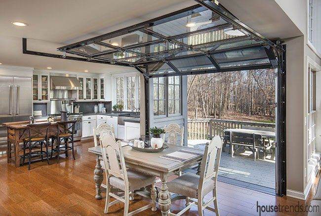 Glass garage door leads to a deck