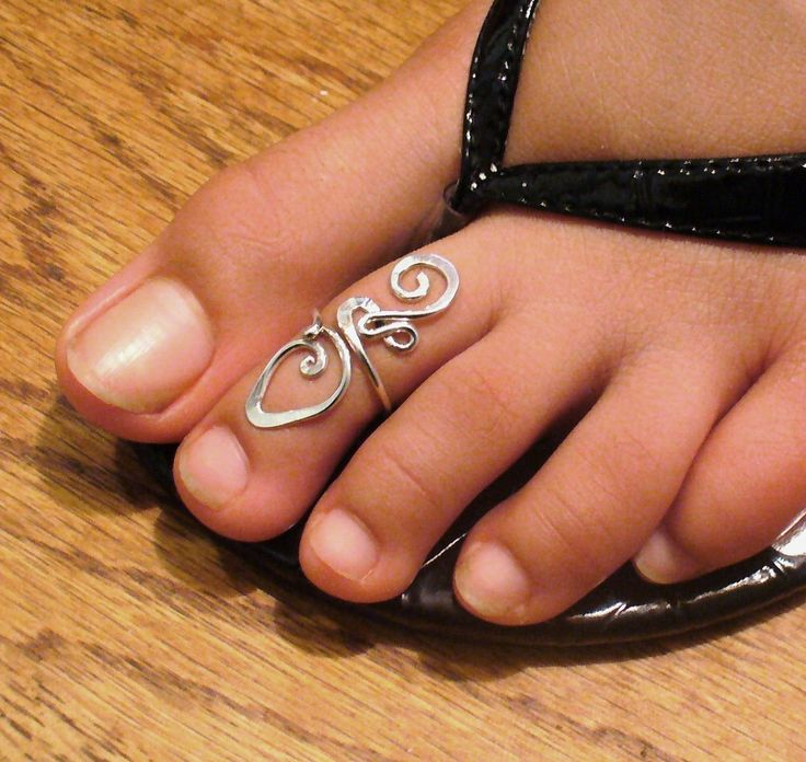 Sterling Silver Toe Ring Twisted Wire Wrapped Cute and Adjustable. $15.00, via Etsy.
