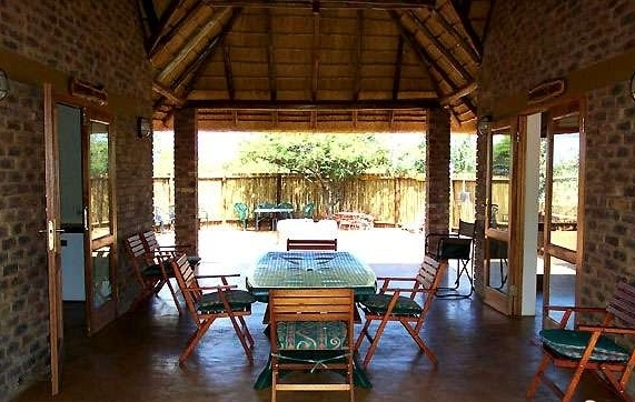 Dinokeng big ha, 4.5m 16 Bed Game Lodge in Pride of Africa, Dinokeng Game Reserve, Pretoria  Neat and established game lodge with four self-catering double facility chalets sleeping a total of 16 for sale in the Dinokeng game reserve near Pretoria.  The main lodge under thatch boasts a conference centre, kitchen, covered patio and outside boma.  Each of the 4 chalets (or houses) under thatch has an open-plan living, dining and kitchen area, 2 bedrooms with bathrooms and a patio, and a boma.