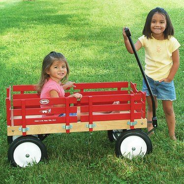 We may be biased, but we think every youngster should have a little red wagon for those all-too-fleeting childhood years. Whether it's a whole day at the zoo, a walk to the library or a stroll down the lane, our wagons are ready for the trip. They're even better than the one you had as a child. Varnished bed of 1/4 plywood (3/8 Masonite on small) Frame of 1/8 black painted steel Small - A practical wagon for toddlers. Plastic 7 tires won't...