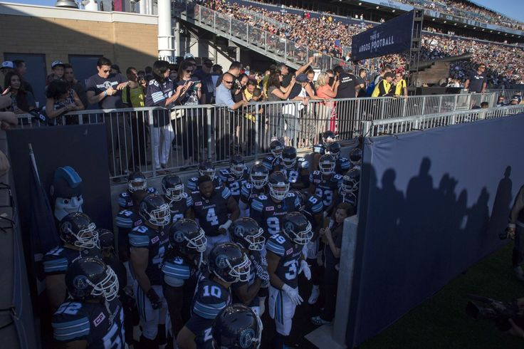WK 1 - June 23 2016 - Ham 42 - Tor 20 - Images: Argos Open New Era at BMO Field - CFL.ca -As fans look on Toronto Argonauts players wait to run onto the pitch before kick off in his team's season opener against Hamilton Tiger-Cats CFL football action in Toronto on Thursday June 23, 2016. THE CANADIAN PRESS/Chris Young