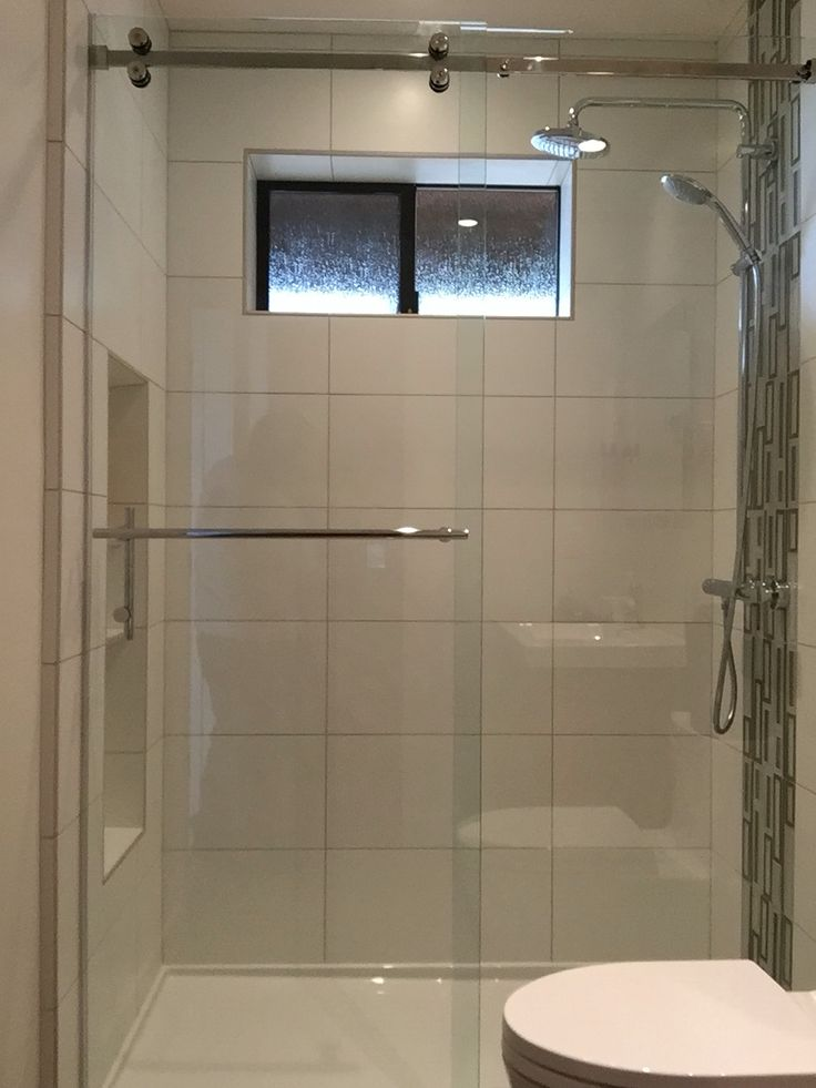 Serenity series frameless sliding shower enclosure 38 clear glass with polished stainless
