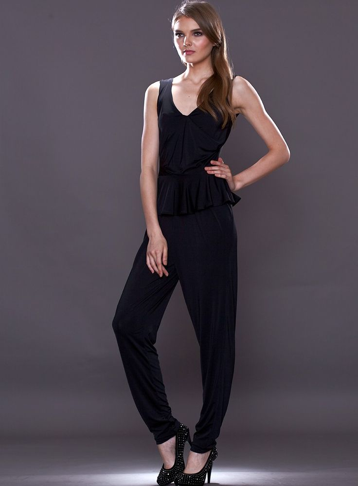 The Fiona Jumpsuit by Pia Gladys Perey is a a sexy V-neck jumpsuit. A slimming style featuring a peplum at the waist. Available in Black.
