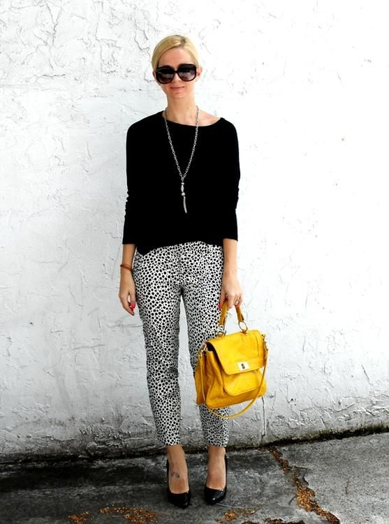black + white pants / black top / yellow bag
