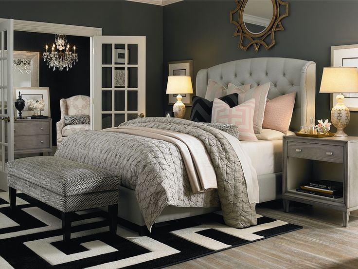 So many great design details in this serene gray bedroom. Mixing shades of gray…