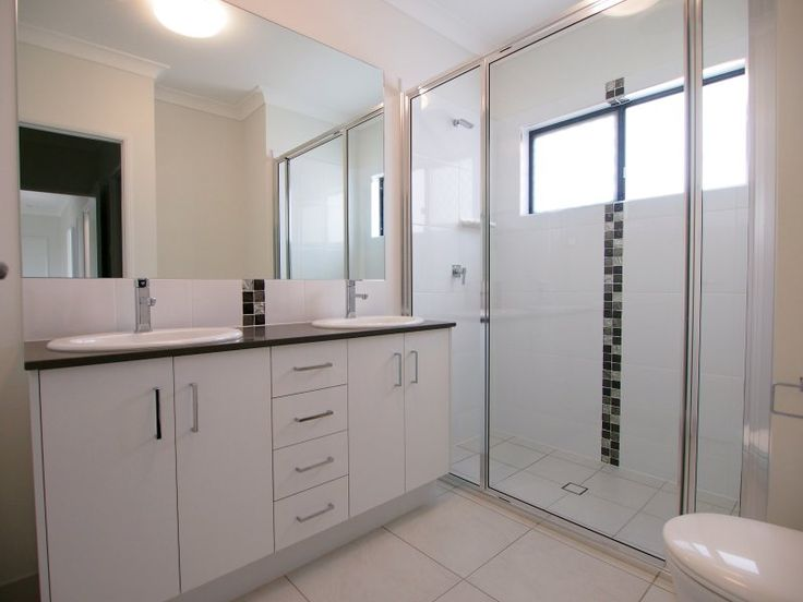 White bathroom with black and grey feature tiles in a new home in kalynda chase built by Grady Homes