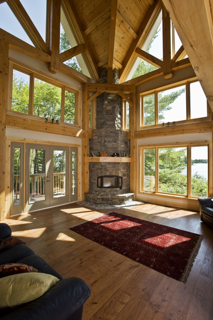 Perfect View of the Gorgeous Fireplace Within Our Island Retreat Home #TimberFrame #Log #Custom #IslandRetreat #Fireplace #DiscoveryDreamHomes