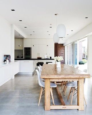 Pale concrete floor...I totally want concrete counters and floors in my kitchen. And all restaurant grade stainless steal equipment
