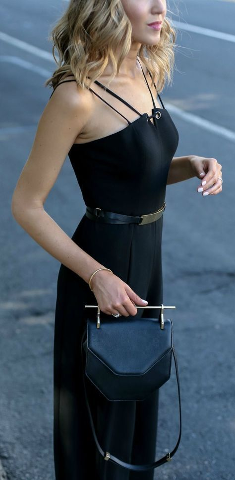 black sleeveless wide leg jumpsuit, gold waist belt, black handbag + curled hairstyle {black halo, b-low the belt, m2malletier} {what to wear to a rehearsal dinner} {little black jumpsuit}