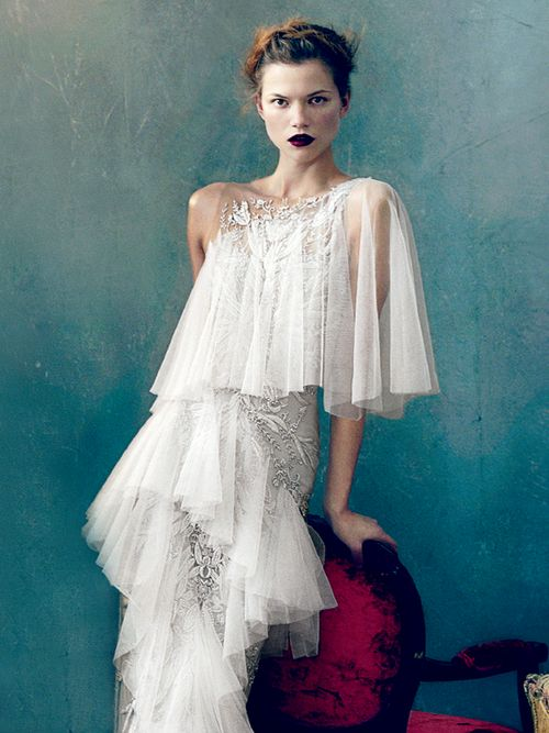"Kasia Struss wearing a white tulle dress in ""Magic Kingdom"" by Norman Jean Roy…"