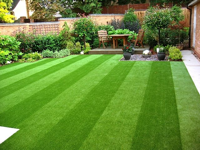 Artificial Grass Garden Designs artificial grass and decking look great with good garden lighting httpwwwisolanaestienda landscaping lawn care pinterest grasses Find This Pin And More On Inspiring Ideas Why Artificial Grass