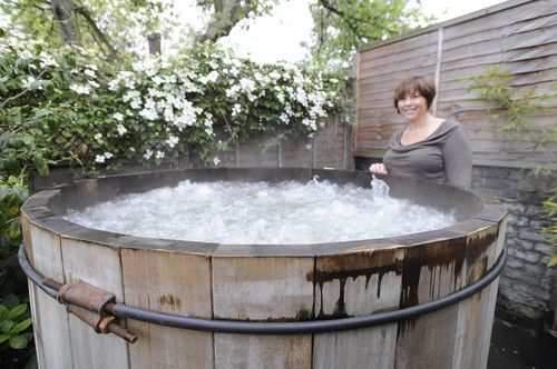 "A hot tub in a ""wood barrel"" - East London Terrace Oasis eclectic"