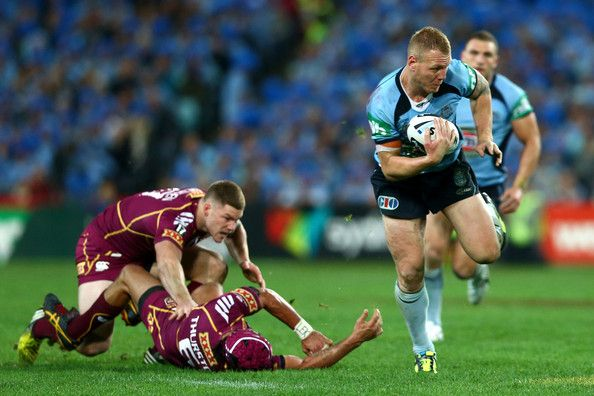 Luke Lewis of the Blues makes a break during game one of the ARL State of Origin series between the New South Wales Blues and the Queensland Maroons at ANZ Stadium on June 5, 2013 in Sydney, Australia.