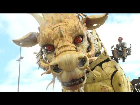 """The French art group """"La Machine"""" unveiled their latest giant streampunk puppet—a fire-breathing, smoke snorting, walking dragon. The project is called Long Ma Jing Shen or """"The Spirit of the Horse Dragon."""""""