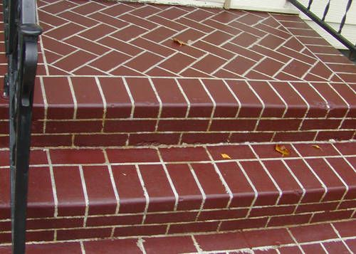 this diy-er painted a plain concrete stoop with some mistint 5$ paint and this is the result! Wow!