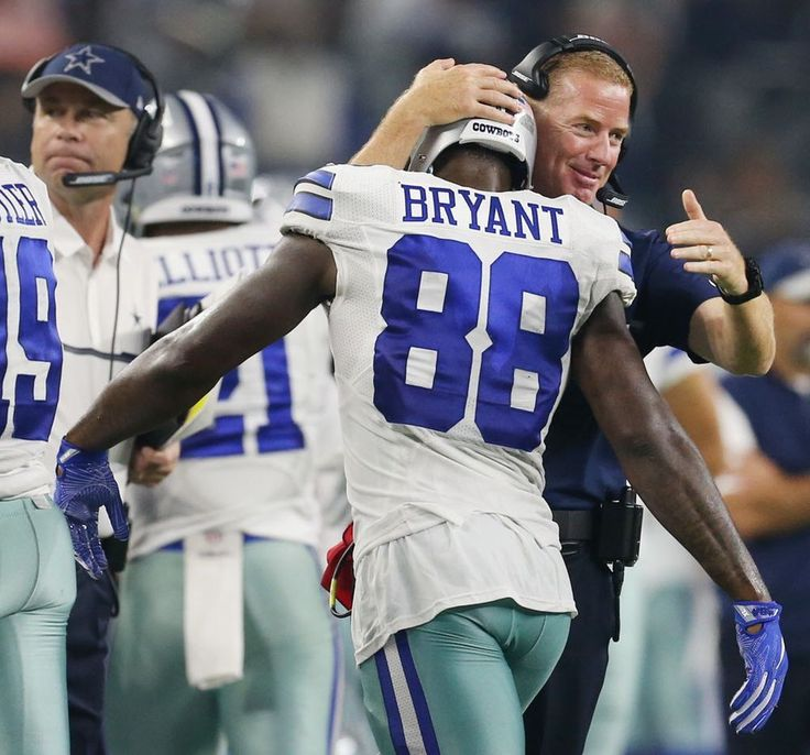 Andy Jacobsohn/Staff Photographer. Dallas Cowboys head coach Jason Garrett celebrates with wide receiver Dez Bryant (88) after Bryant caught a pass for a touchdown to make the score 30-10 in the second half during a National Football League game between the Chicago Bears and Dallas Cowboys at AT&T Stadium in Arlington, Texas Sunday September 25, 2016. The Dallas Cowboys beat the Chicago Bears 31-17. (Andy Jacobsohn/The Dallas Morning News)