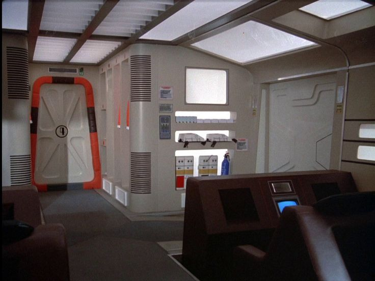 Interior, passenger module of Eagle set from the the television show Space: 1999. View of forward bulkhead and door leading to corridor  connecting the command module.