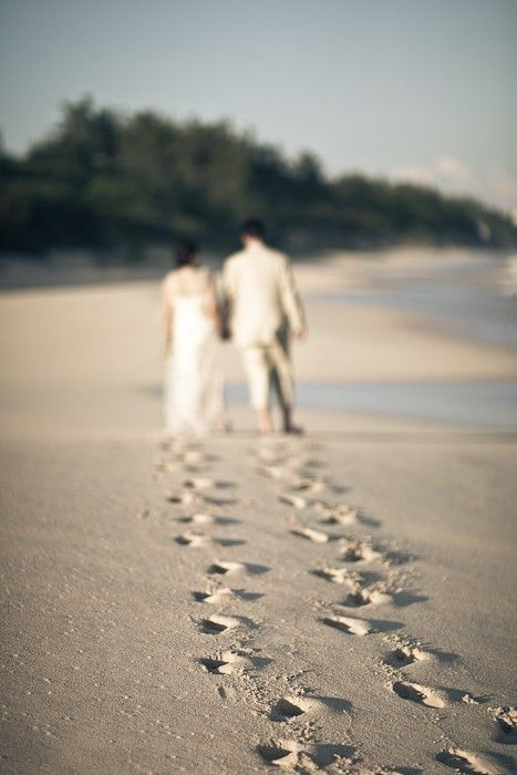 I love the perspective of this wedding photograph, focusing on the footprints of…