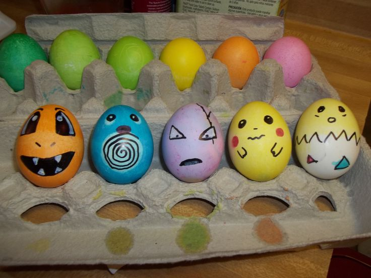 Me and Eli made pokemon easter eggs today. :) from left to right.. charmander, poliwag, exeggcute, Pikachu and tokapi