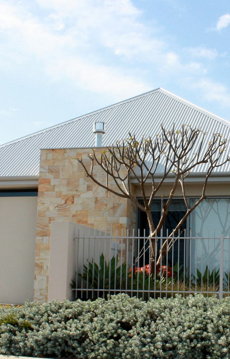 Contemporary Sandstone chimney feature.
